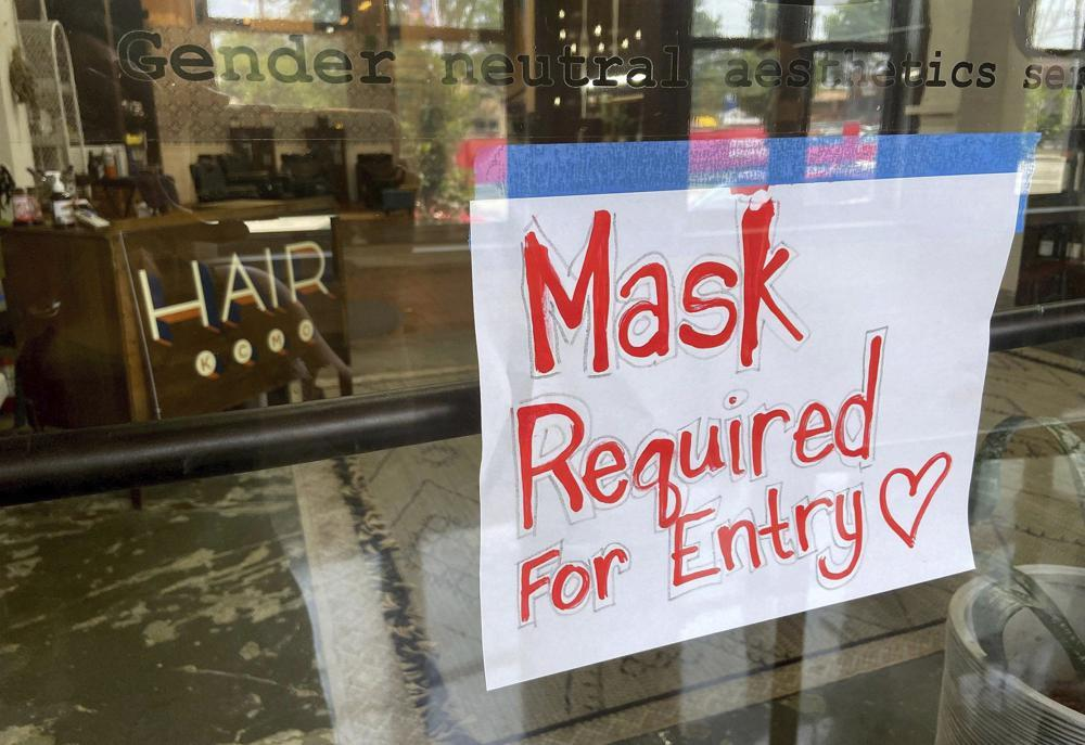 Weary US businesses confront new round of mask mandates